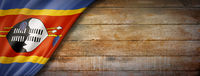 Swaziland flag on vintage wood wall banner