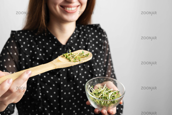 Caucasian young beautiful woman with microgreens salad superfood, healthy lifestyle