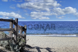 Wood fence leading down to the beach