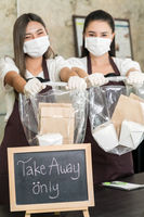 waitress wear protective face mask hold food bag