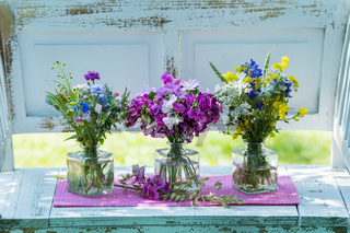 Three little bouquets with wildflowers