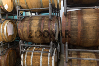 wooden barrels at craft brewery or winery