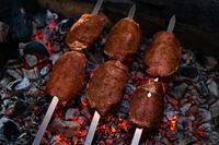Delicious sausages on skewers during camp