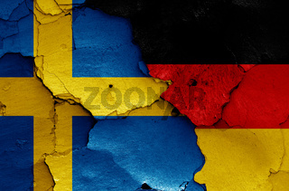 flags of Sweden and Germany painted on cracked wall