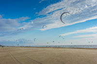 Kite surfing at the summer beach with blue sky