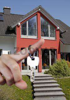 Hand mit Hausschlüssel