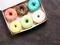paper box with colorful donuts, top view, copy space