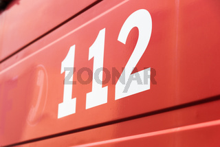 112 the emergency number on a red background