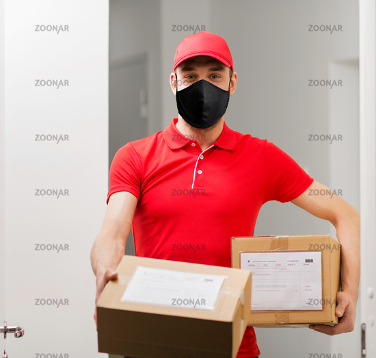 delivery man in mask with parcel boxes