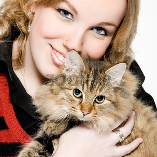 Portrait of a blond curly woman with cute kitten