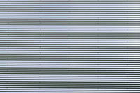 Corrugated metal sheet. New and Modern silver grey background pattern.