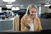 Businesswoman using headset at modern office