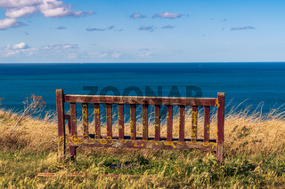 A bench with a view towards the North Sea Coast in Kettleness, England, UK
