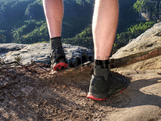Young man strong legs off trail running in amazing land