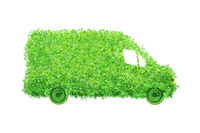 Isolated delivery van made of leaves. Electric cargo car, transportation and environmental concept.