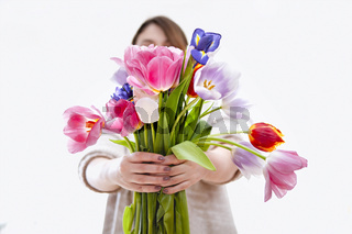 Woman with bouquet of colorful tulips