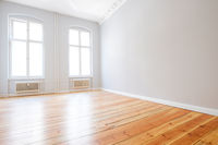 empty apartment room with wooden floor in new flat -