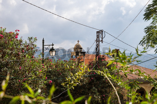 Churchtower, powerlines and bushes in Deir el Qamar, Lebanon