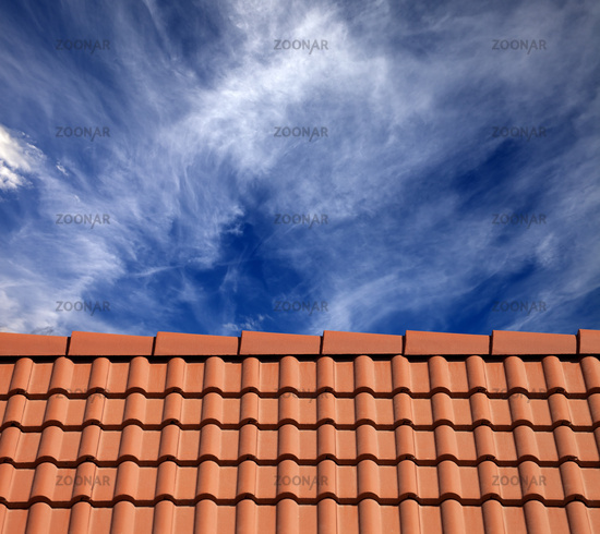 Roof tiles and sky with clouds at sun day