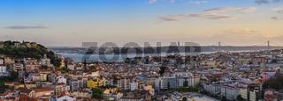 Lisbon Portugal aerial view sunset panorama city skyline at Lisbon Baixa district and Saint George Castle