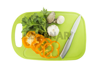 Parsley and mushroom on green Plastic board