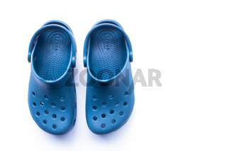 Calgary, Alberta, Canada. Nov. 19, 2020. Blue Crocs footwear, foam clog shoes on a white background.