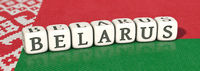 White dices with the word BELARUS on belarus flag