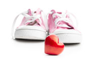 Valentine's Day love concept. Pink sneakers and red heart