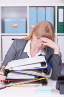 Overwhelmed woman at the office. Overworked, burnout and stress concept.