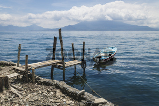 Boat at jetty along lake Atitlan at the coast of Santa Cruz la Laguna, Guatemala