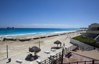 CANCUN, MEXICO- FEBRUARY 7, 2010:coastal beach area with shore reinforcement pipes