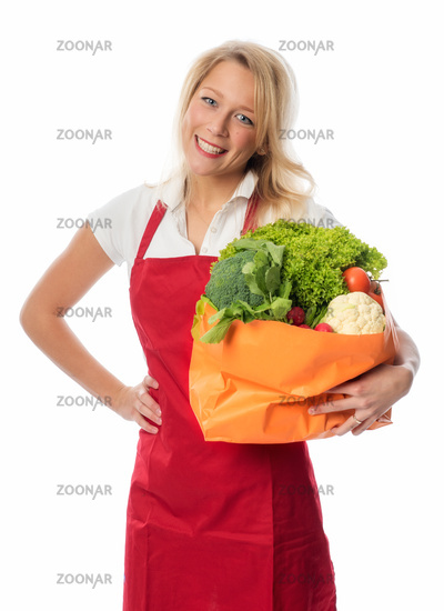 woman with skirt carrying bag with vegetables