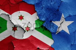flags of Burundi and Somalia painted on cracked wall
