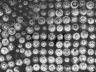 Old used batteries group. Top view background texture. Black and white