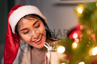 asian woman holding Christmas ornament for decorate on christmas tree