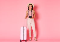 Tourism, summer vacation, holidays abroad concept. Full length of beautiful smiling girl traveller in hat, tourist with camera and suitcase showing thumbs-up, recommend travel agency