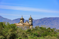 Rear view of historic church in baroque and colonial style from the 18th century amid the hills and