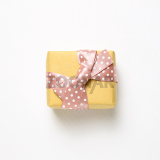 Yellow gift box isolated on white background