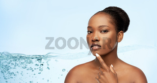 portrait of african woman touching her face