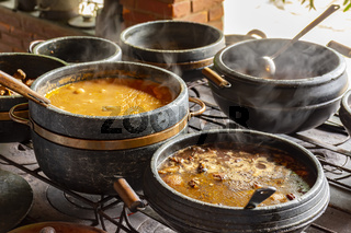 Typical Brazilian cuisine placed in clay pots