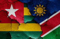 flags of Togo and Namibia painted on cracked wall