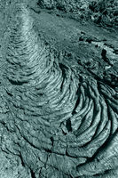 Creative volcanic background: undulating surface frozen lava flow