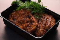 Tasty meat steak with dill high angle view