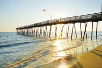 Avalon Pier and beach at the Outer Banks of North Carolina at sunrise