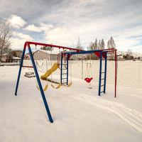 Square Kids playground in winter snow day light