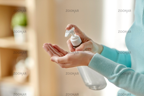 close up of woman applying hand sanitizer