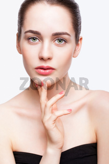 Young beautiful woman with day makeup and  green pistachio colour eyes