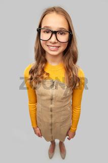 smiling teenage student girl in glasses