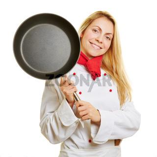 Köchin mit Bratpfanne