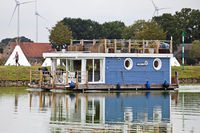 Houseboat on the Dortmund-Ems Canal and jogger on Canal Path, Hoerstel,Germany, Europe